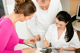104499733_Woman_at_reception_of_clinic.jpg