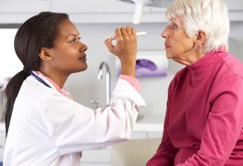 female-doctor-checking-vision-of-an-elderly