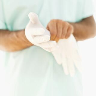 56570121_Close-up_of_a_person_putting_on_surgical_gloves-1.jpg