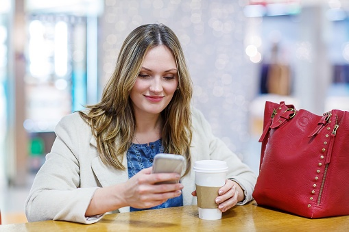 Young woman with phone on social media
