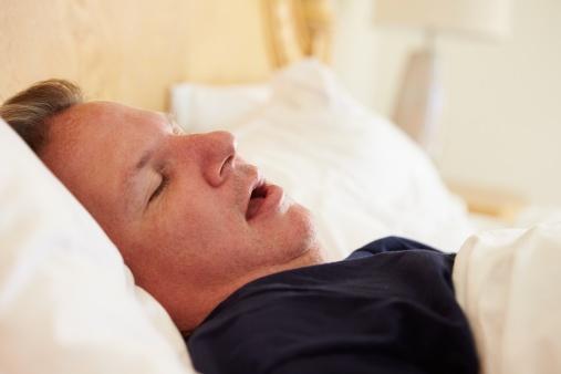 506933401Overweight_Man_Asleep_In_Bed_Snoring.jpg