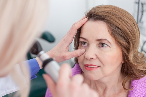 middle aged women getting her eye tested