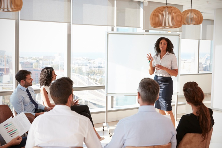 677893280 - businesswoman making presentation