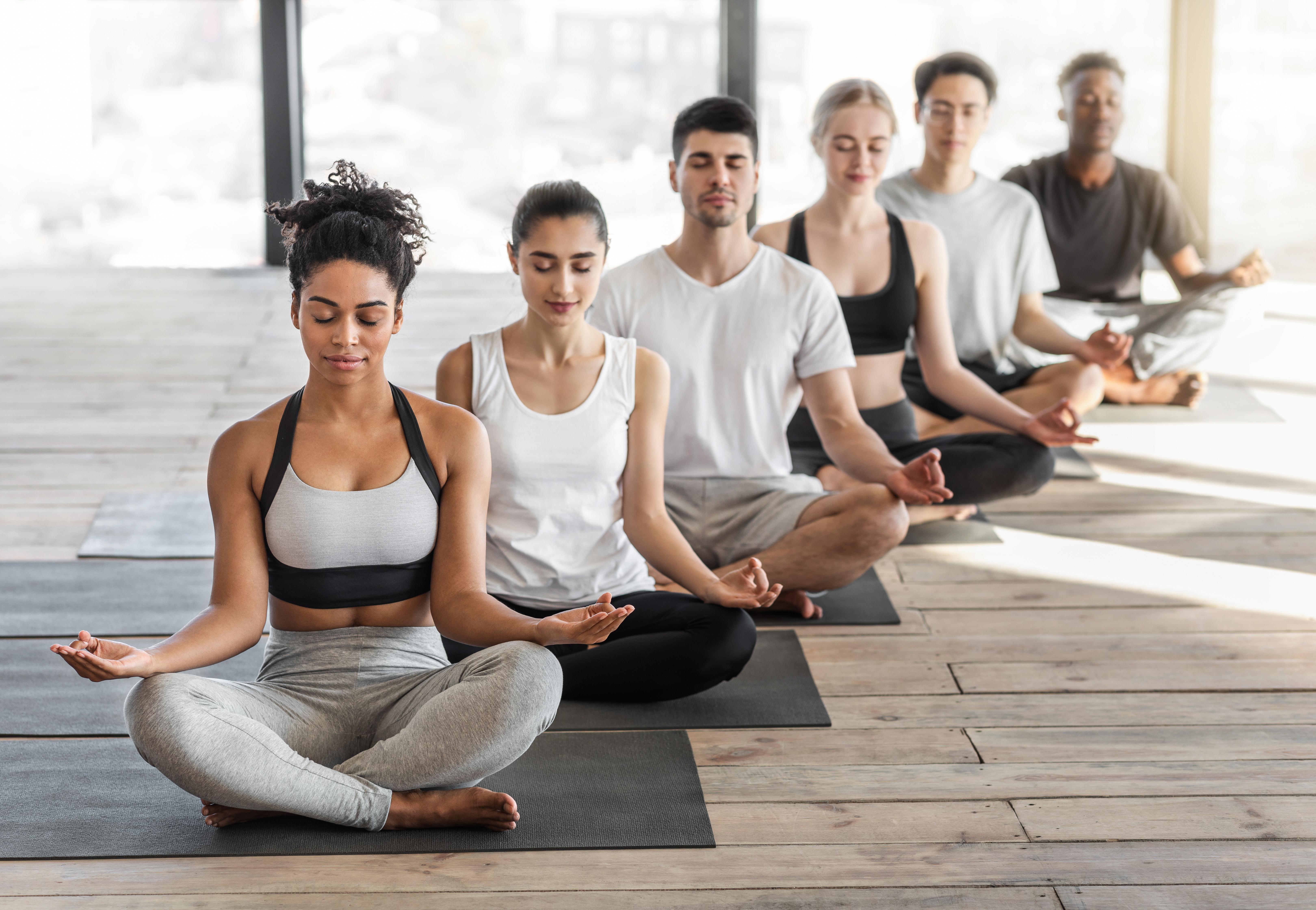 Group meditating during wellness program activity