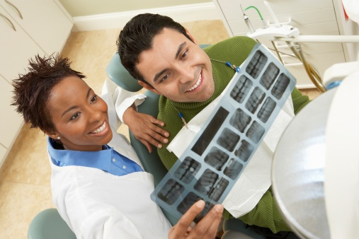 77736608_Dentist_and_Patient_Examining_X-ray.jpg