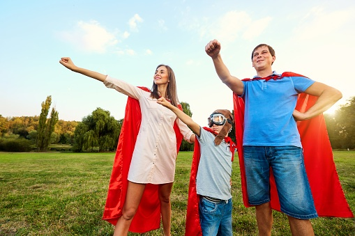 Superheroes family. Mother, father and son costumes.jpg