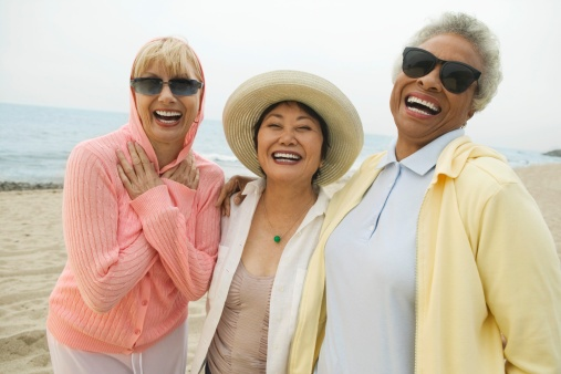 ThinkstockPhotos-77736736 Friends Laughing at Beach