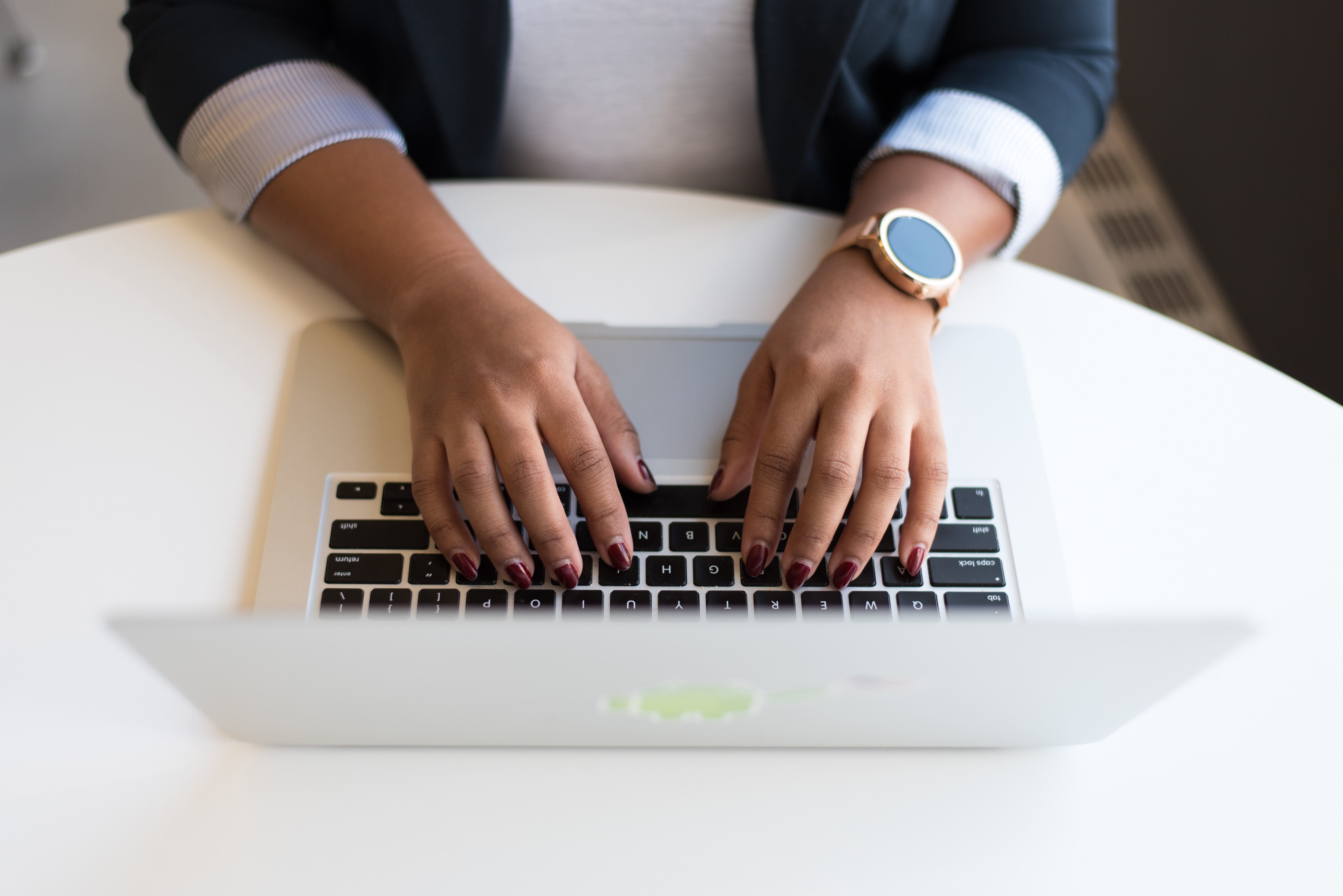 business woman on computer looking up virtual business cards