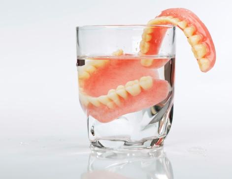 dentures vs dental implants. pros & cons of each