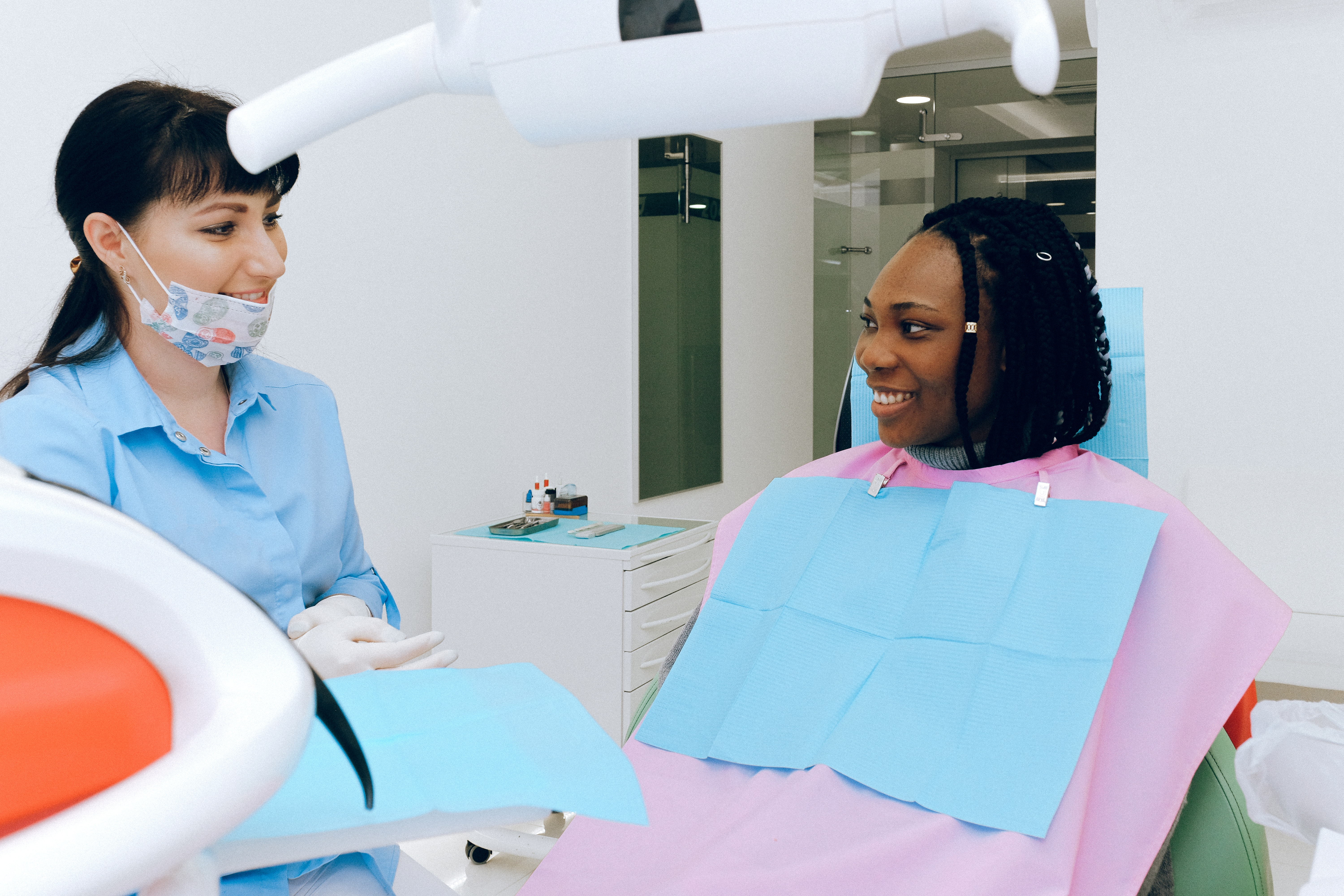 Woman and dentist talking about dental insurance