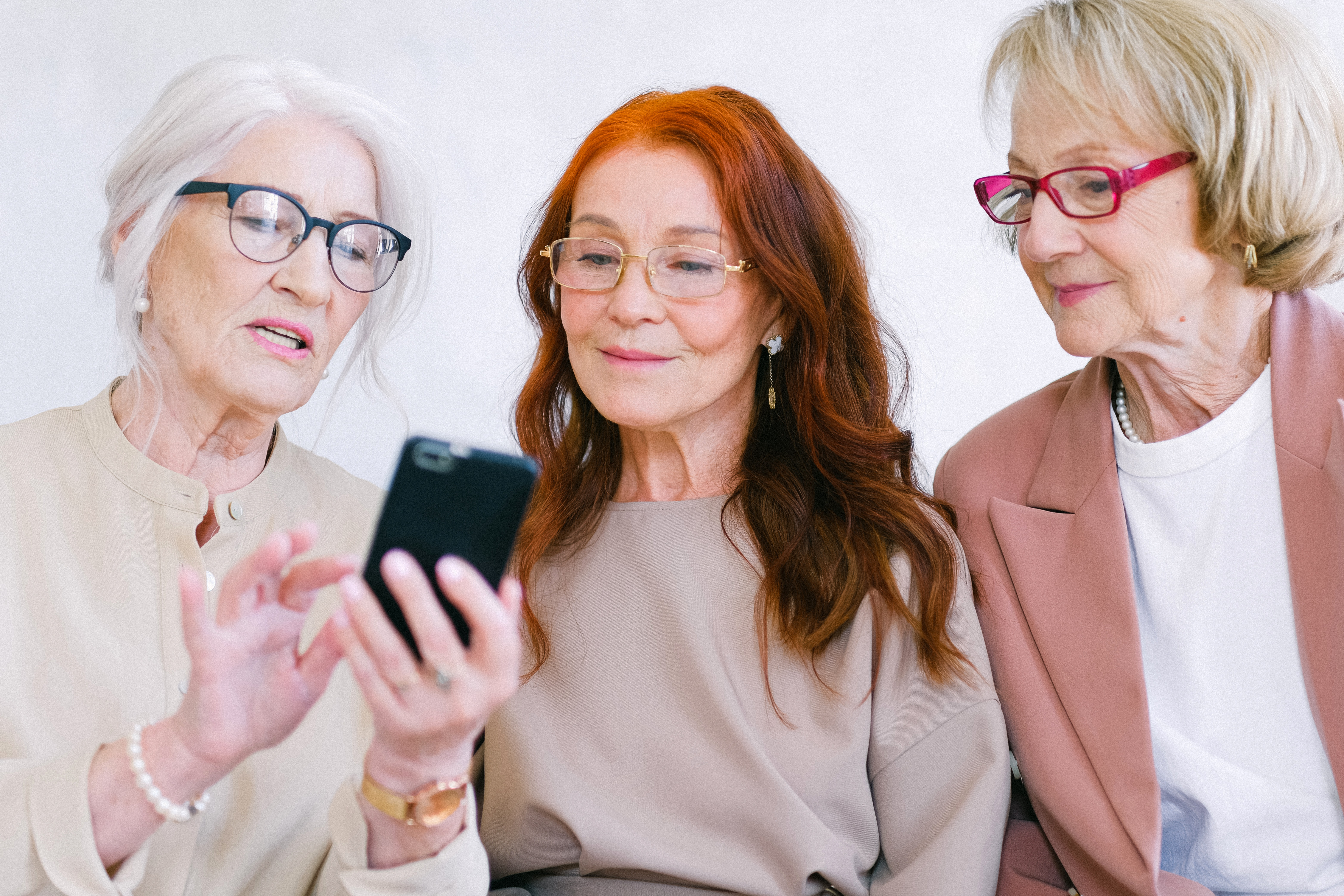 Woman explaining to her friends why dental care is important to retirees