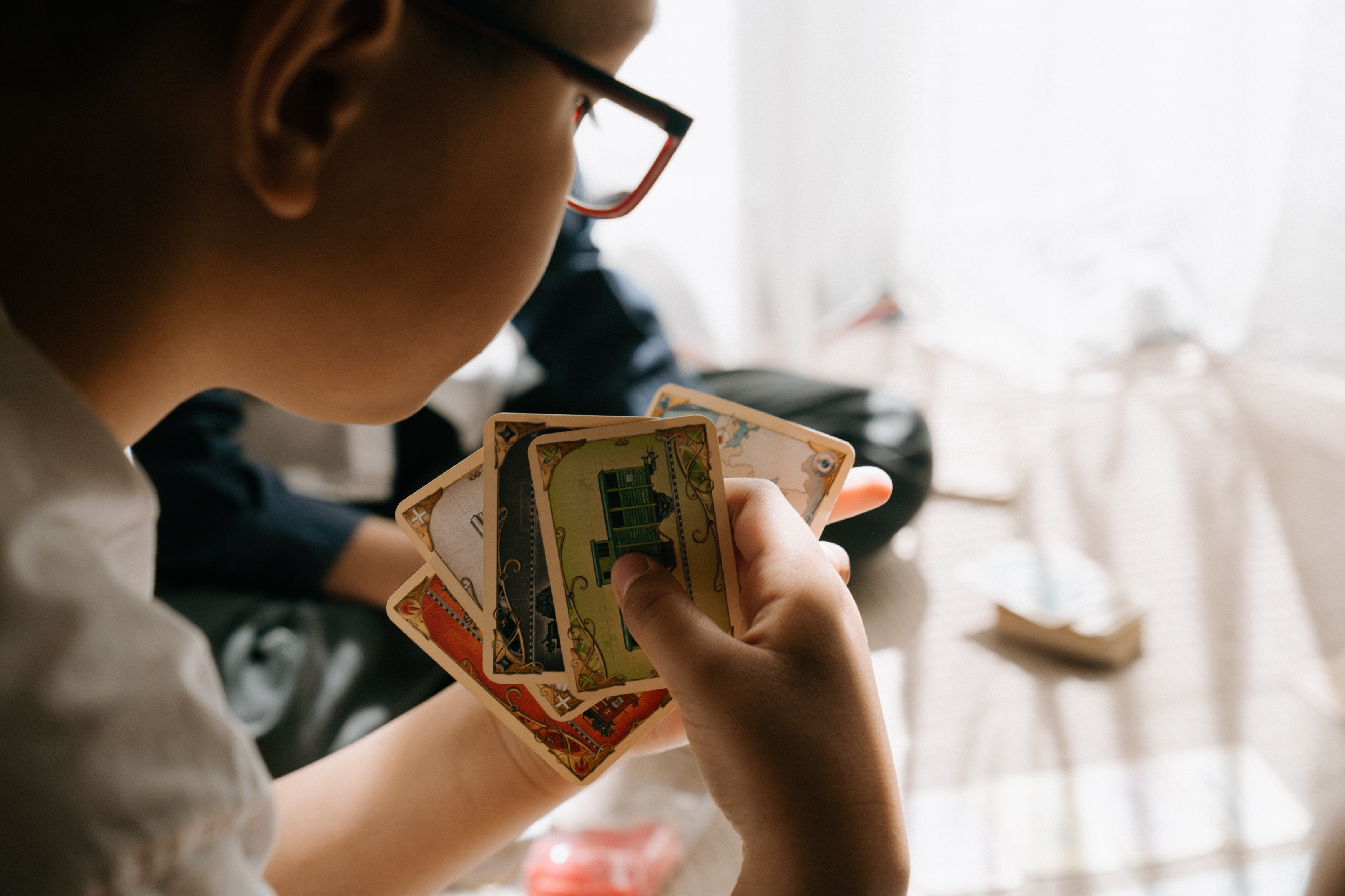 child-playing-a-card-game